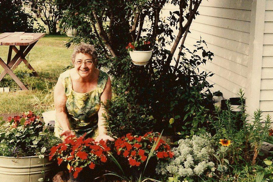 My grandmother working in her flower garden.