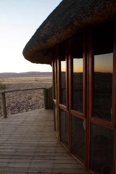 Reflection in windows of guest room at Sossous Dunes Lodge