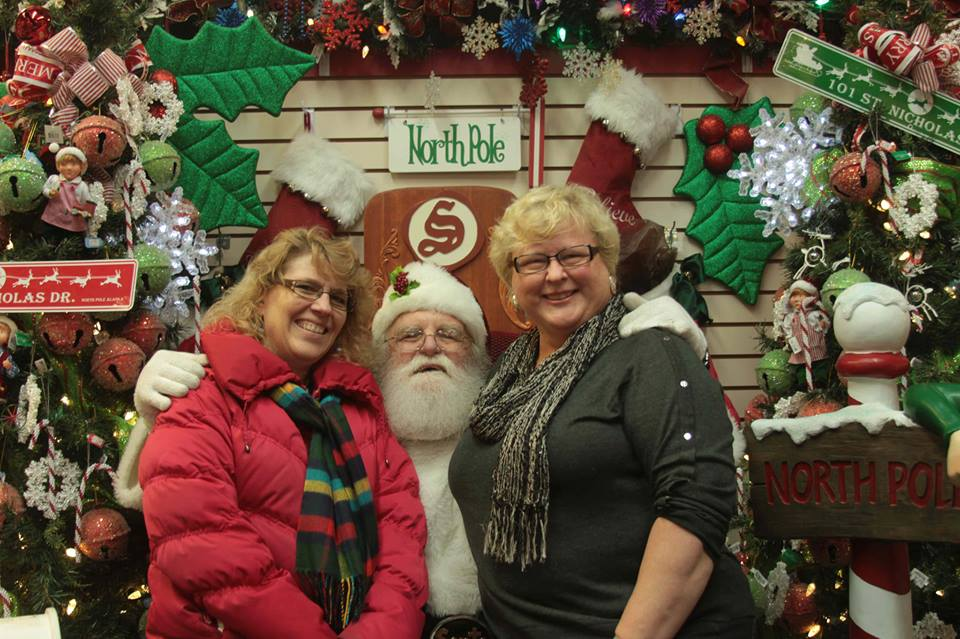 My sister Ruth and I get get cozy with Santa