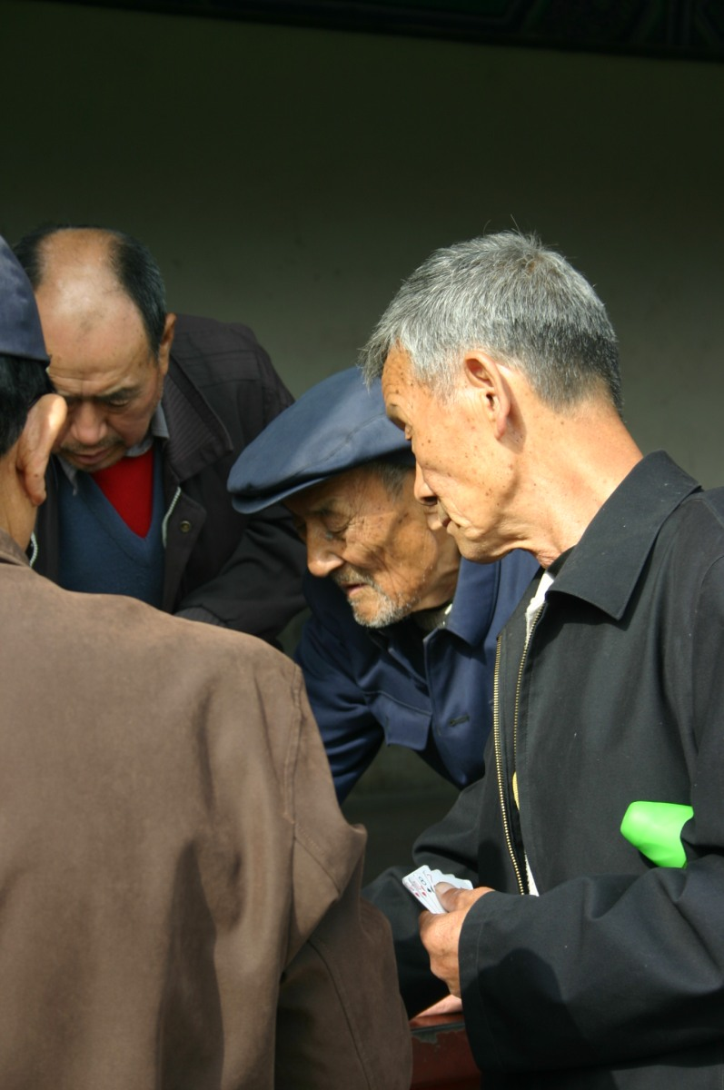 Card players on the grounds of the Temple of Heaven in Beijing.