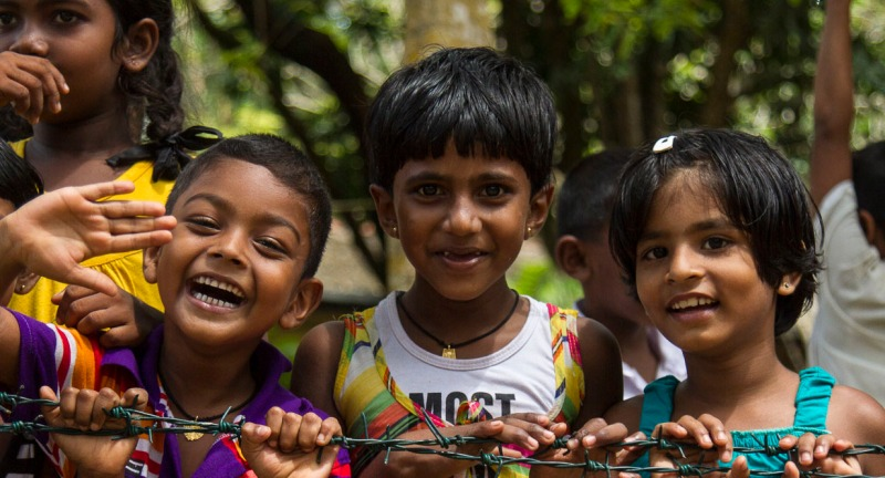 Young school children on island in Madu Ganga River, Sri Lanka