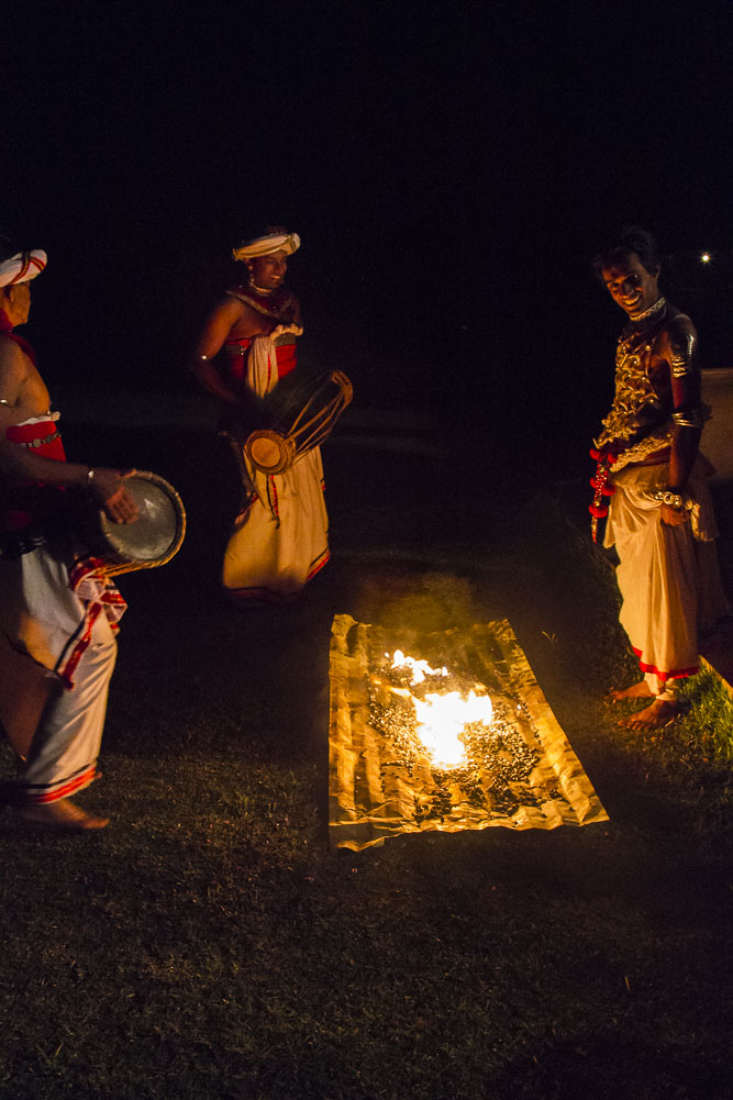 Playing with Fire. Sri Lanka dance group in traditional Kandy region costumes prepare to fire walk.