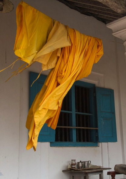 Monks robes drying on the temple porch.  Temple is located on a island in Madu Gange