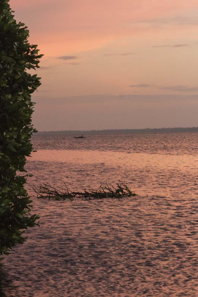 Melon sunset on bay in the Indian Ocean, near Negombo, Sri Lanka.