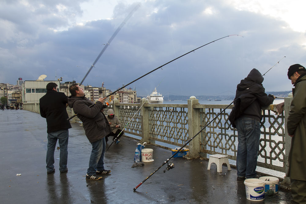 Fishing from Galata Bridge, Istanbul, Turkey