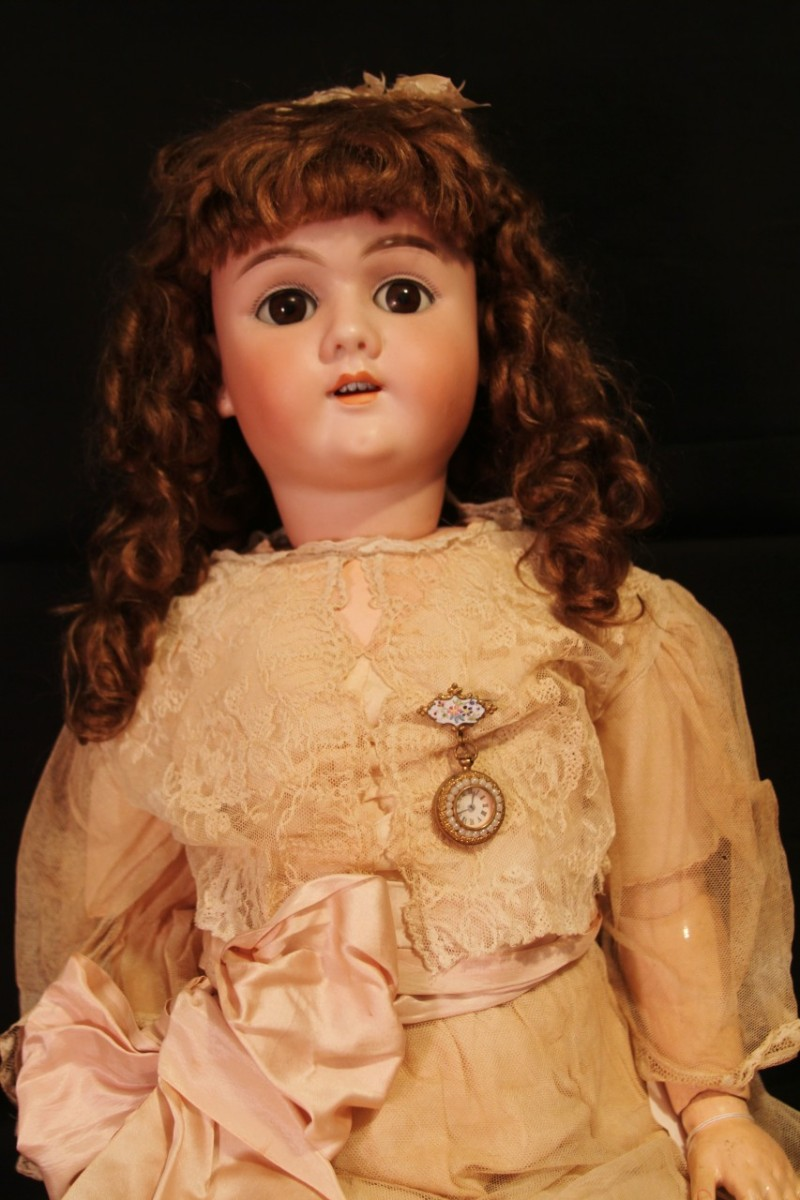 Vintage Doll Wearing Apricot Dress