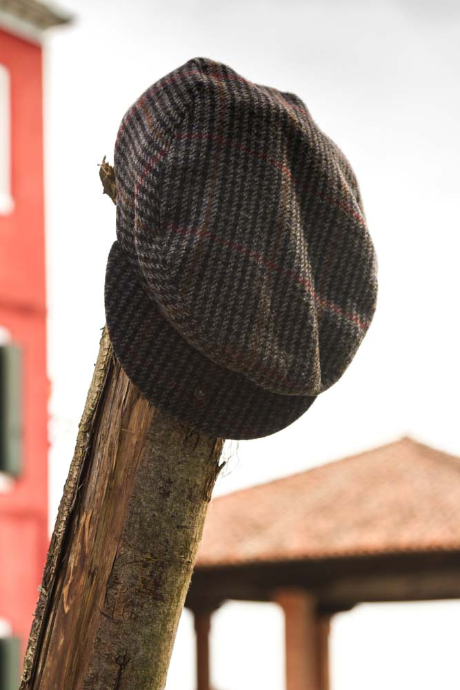 Hat on a mooring pole, Burano, Italy