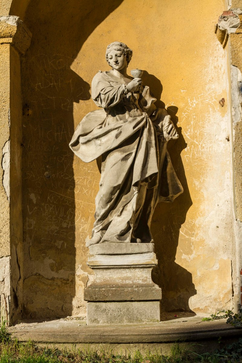 Statue set in niche of wall across from Saints Peter and Paul Cathedral, Brno, Czech Republic