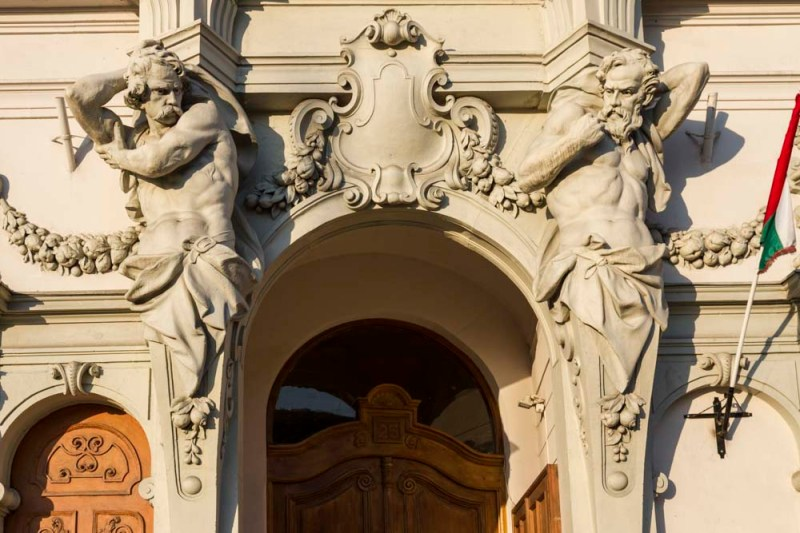 Statues decorating facade of building in Budapest, Hungary