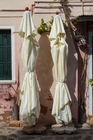 Closed umbrellas, Burano, Venice, Italy