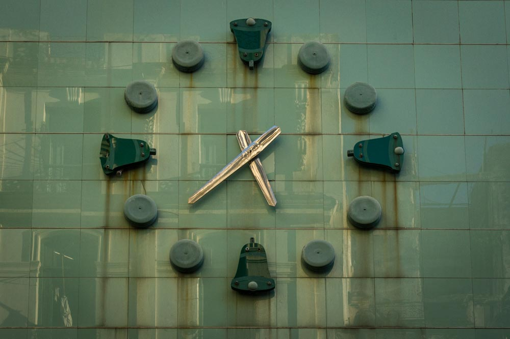 Clock on facade of closed department store, Havana, Cuba