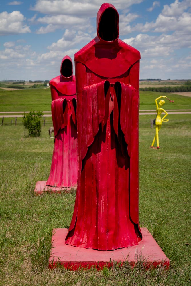 The two red monks with the yellow lady in the distance, South Dakota